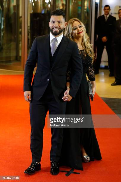 Argentine soccer player Sergio Aguero and his girlfriend Argentine singer Karina Tejada also known as 'La Princesita' pose for pictures during Lionel...