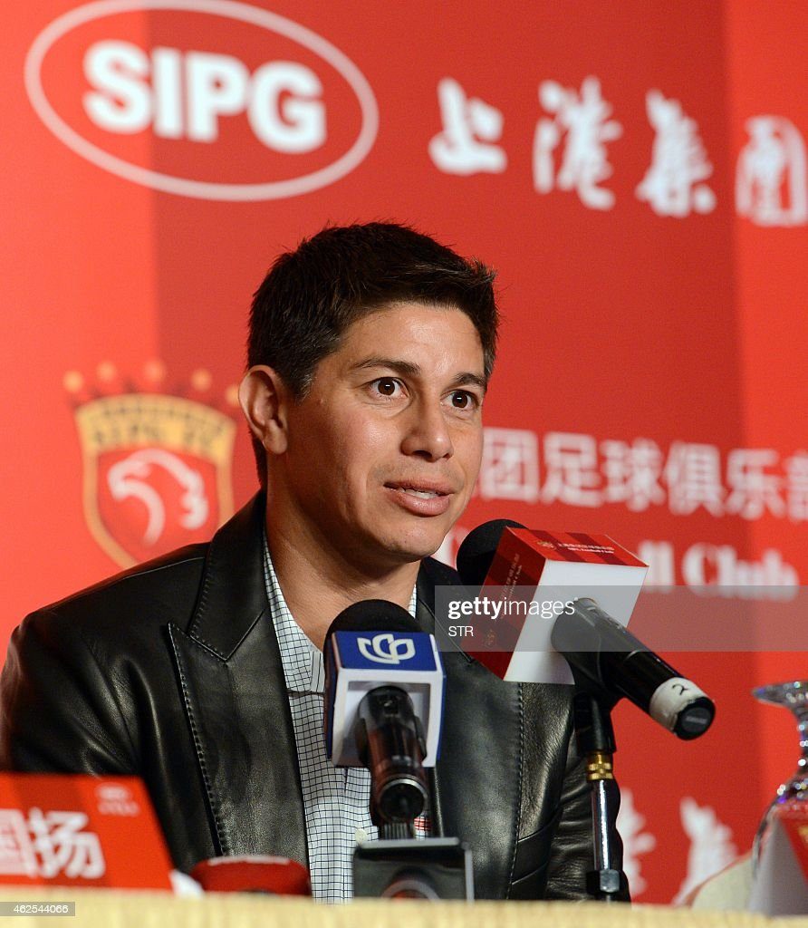 Argentine star Dario Conca answers questions during a press conference after signing with Chinese Super League football club Shanghai SIPG in...
