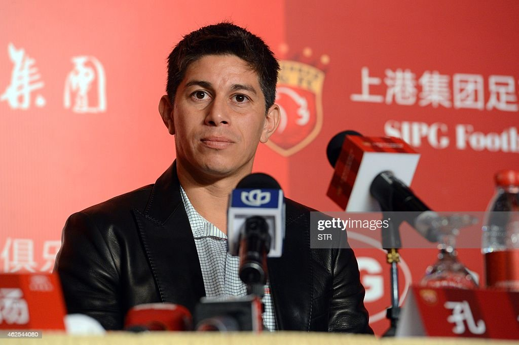 Argentine star Dario Conca listens to a question during a press conference after signing with Chinese Super League football club Shanghai SIPG in...
