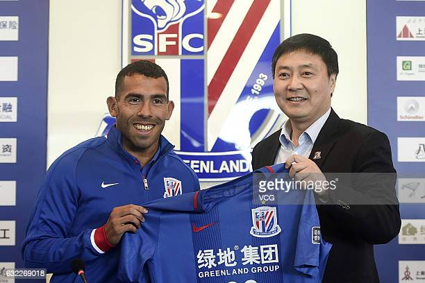 Argentine striker Carlos Tevez and Shenhua general manager Wu Xiaohui attend a press conference on January 21 2017 in Shanghai China Carlos Tevez...