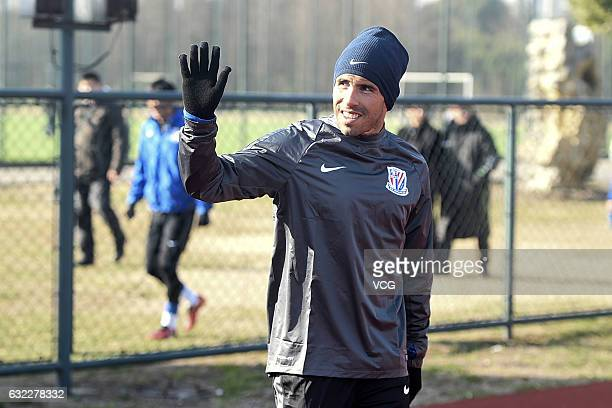Argentine striker Carlos Tevez waves his hand during his first training session with his new club Shanghai Shenhua on January 21 2017 in Shanghai...