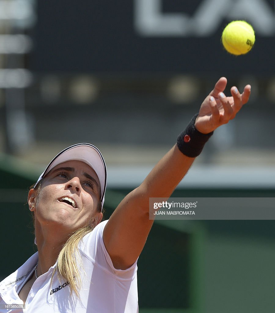 Argentine tennis player Florencia Molinero serves against Swedish Johanna Larsson during their 2013 Fed Cup World Group II first round single tennis match at Parque Roca stadium in Buenos Aires on February 10, 2013. AFP PHOTO / Juan Mabromata
