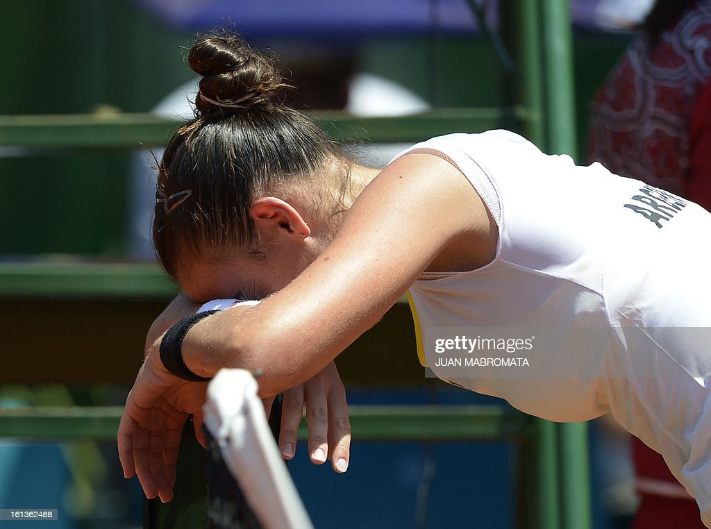Argentine tennis player Paula Ormaechea reacts after retiring from their 2013 Fed Cup World Group II first round single tennis match against Swedish Sofia Arvidsson, at Parque Roca stadium in Buenos Aires on February 10, 2013. Arvidsson won 7-5, 6-7, 3-2 (ret). AFP PHOTO / Juan Mabromata