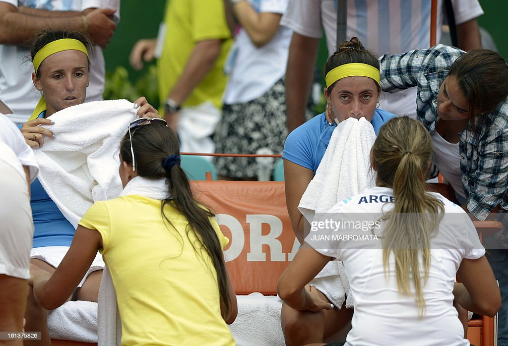 Argentine tennis players Maria Irigoyen (L) and Mailen Auroux (2-R) gesture in dejection after being defeated by Swedish tennis players Sofia Arvidsson and Johanna Larsson by 4-6, 4-6 in their 2013 Fed Cup World Group II first round doubles tennis match at Parque Roca stadium in Buenos Aires on February 10, 2013. Sweden won the series by 3-2. AFP PHOTO / Juan Mabromata