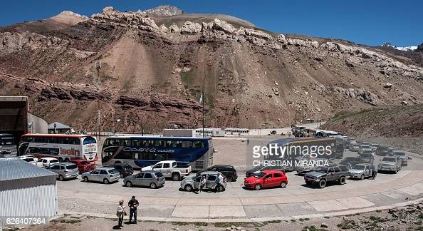 Argentine tourists wait at the custom in the border between Chile and ...