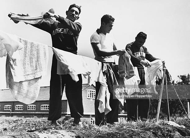 Argentine track athletes Adan Torres Fernando Lapuente and Delfo Cabrera do their own laundry whilst in London for the 1948 Summer Olympics