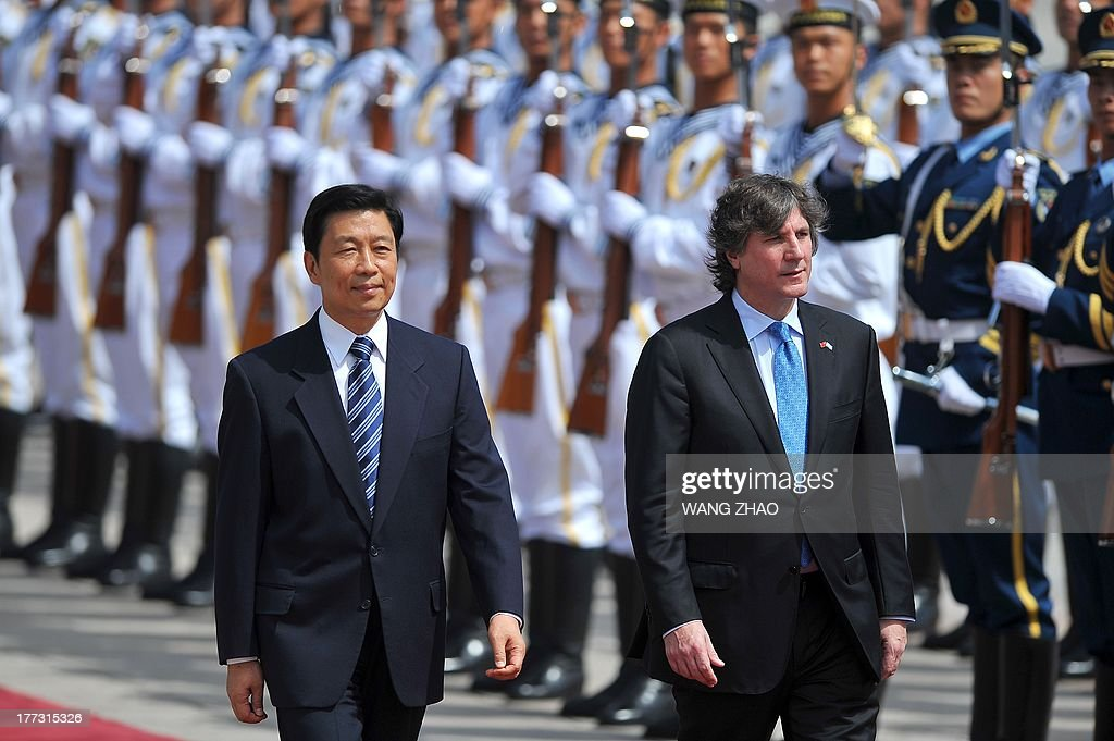 Argentine Vice President Amado Boudou (R) and Chinese Vice President Li Yuanchao inspect Chinese honour guards during a welcome ceremony outside the Great Hall of the people in Beijing on August 23, 2013. Boudou is on a visit to China from August 21 to 24.