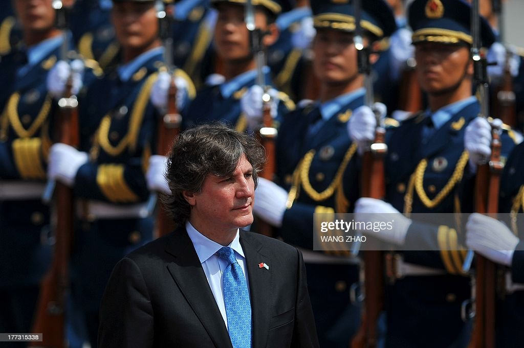 Argentine Vice President Amado Boudou and Chinese Vice President Li Yuanchao (not in picture) inspect Chinese honour guards during a welcome ceremony outside the Great Hall of the people in Beijing on August 23, 2013. Boudou is on a visit to China from August 21 to 24.