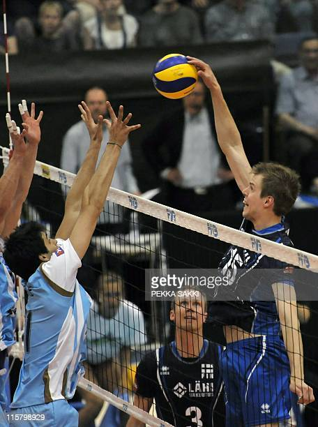 Argentinean Sebastian Sole Finnish Mikko Esko and Matti Oivanen compete during the World League volleyball match Finland vs Argentina opn June 10...