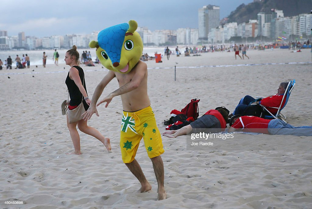 Argentinean soccer team fan, Juan Pablo, from Argentina, wears a replica head of the FIFA mascot as he enjoys Copacabana beach while waiting for the start of the 2014 FIFA World Cup on June 11, 2014 in Rio de Janeiro, Brazil. Brazil continues to prepare to host the World Cup which starts on June 12th and runs through July 13th.
