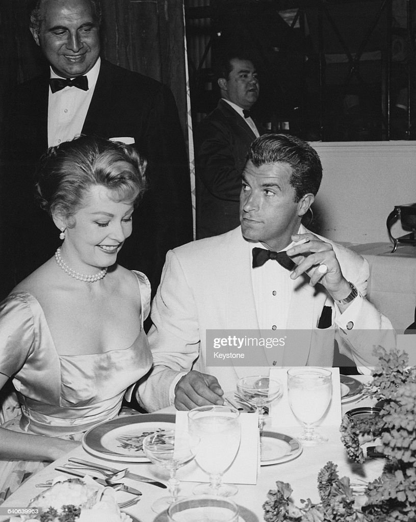 Argentine-born actor and director Fernando Lamas (1915 - 1982) with his wife, actress <a gi-track='captionPersonalityLinkClicked' href=/galleries/search?phrase=Arlene+Dahl&family=editorial&specificpeople=208163 ng-click='$event.stopPropagation()'>Arlene Dahl</a> at an evening event, USA, circa 1957.