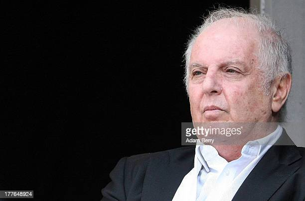 ArgentineIsraeli Conductor Daniel Barenboim listens to the WestEastern Divan Orchestra during a lastminute rehearsal for a concert at Waldbuehne on...