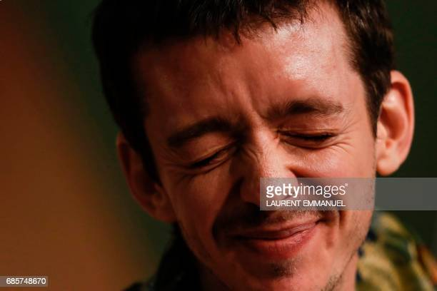 Argentinian actor Nahuel Perez Biscayart grimaces during a press conference for the film '120 Beats Per Minute ' at the 70th edition of the Cannes...