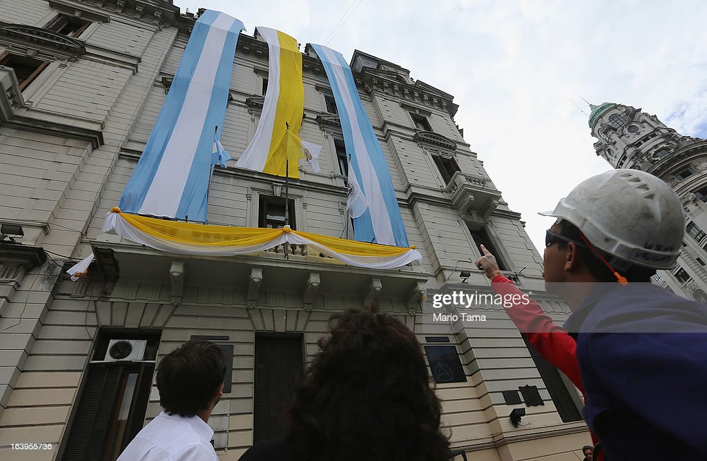 Argentinian and Papal flags honoring Pope Francis hang along Plaza de Mayo on March 18, 2013 in Buenos Aires, Argentina. Francis was the archbishop of Buenos Aires and is the first Pope to hail from South America. Francis will be officially installed as Pope tomorrow at Saint Peter's Square and the event will be broadcast live in Plaza de Mayo for Buenos Aires residents.