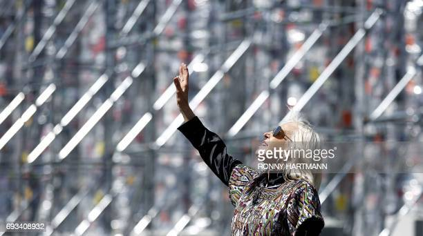 Argentinian artist Marta Minujin gestures inside the 'Parthenon of Books' at the Documenta 14 art exhibition in Kassel on June 7 2017 The Parthenon...