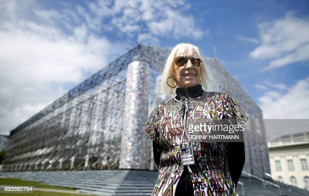 Argentinian artist Marta Minujin poses in front of the 'Parthenon of Books' at the Documenta 14 art exhibition in Kassel on June 7 2017 The Parthenon...