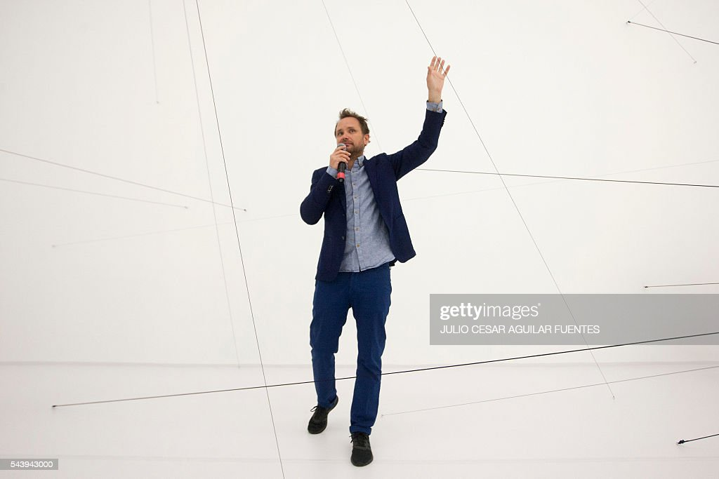 Argentinian artist Tomas Saraceno speaks during his first large exhibition in Latin America of Argentinian called 'One hundred sixty-three thousand light years', in the Museum of Contemporary Art in Monterrey, Nuevo Leon, Mexico, on June 30, 2016. / AFP / Julio Cesar Aguilar Fuentes
