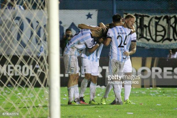 Argentinian Atletico Tucuman player David Barbona celebrates with teammates after scoring against Bolivian Wilstermann during their Libertadores Cup...