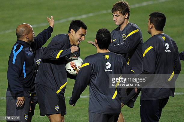 Argentinian Boca Juniors' footballers joke during a training session at Pacaembu stadium in Sao Paulo on July 3 2012 Boca Juniors will face Brazilian...