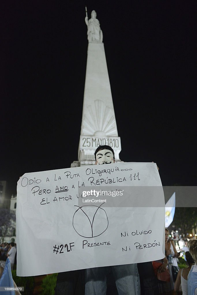 Argentinian citizen holds a poster during a protest against the government of Cristina Kirchner at Plaza de Mayo on November 08, 2012 in Buenos Aires, Argentina. This protest is also known as 8N, as it is held on November 8th. Protestors have conducted the build-up of the march via Internet's major social networks.