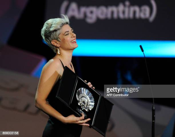 Argentinian director Anahi Berneri holds her 'Concha de Plata' best director award for her film 'Alanis' during the 65th San Sebastian Film Festival...