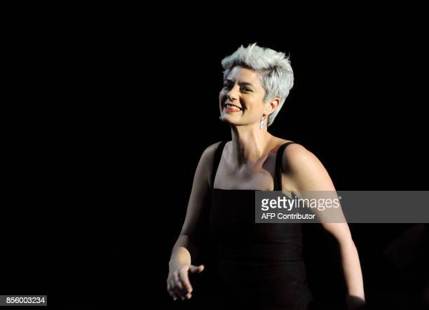 Argentinian director Anahi Berneri smiles before receiving the 'Concha de Plata' best director award for her film 'Alanis' during the 65th San...