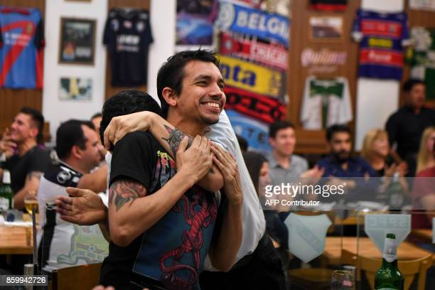 Argentinian fans react while watching the 2018 World Cup qualifier football match between Argentina and Ecuador in downtown Buenos Aires Argentina on...