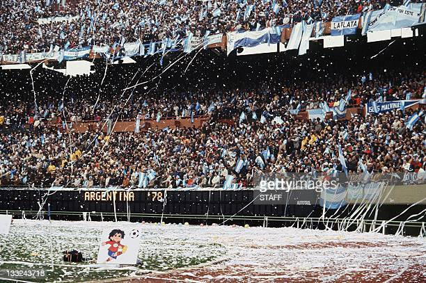 Argentinian fans throw rolls of paper all over the stadium as they wait for the start of the World Cup final between Argentina and the Netherlands 25...