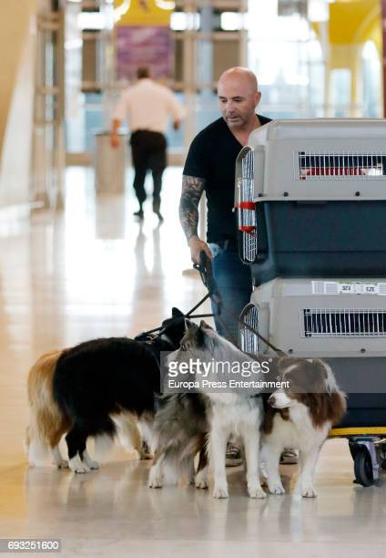 Argentinian football coach Jorge Sampaoli and his dogs are seen on May 24 2017 in Madrid Spain