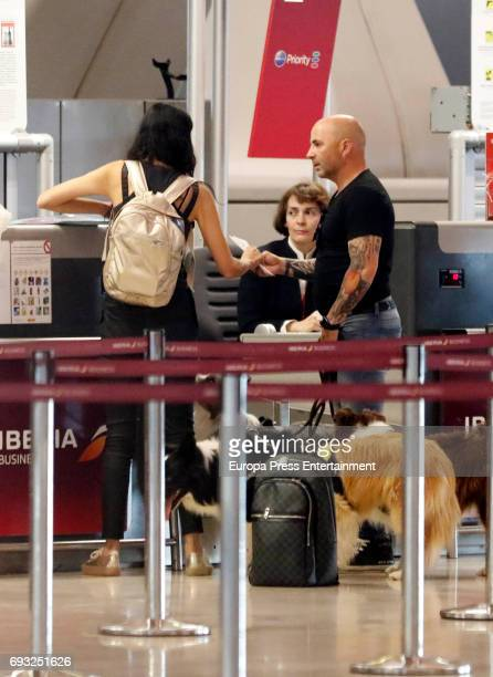 Argentinian football coach Jorge Sampaoli his girlfriend Paula Valenzuela and their dogs are seen on May 24 2017 in Madrid Spain