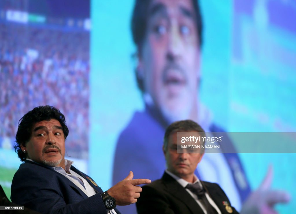 Argentinian football icon and former player Diego Maradona (L) and Real Madrid's Portuguese coach Jose Mourinho attend a panel discussion during the first session of the International Sports Conference in Dubai on December 28, 2012. AFP PHOTO/MARWAN NAAMANI