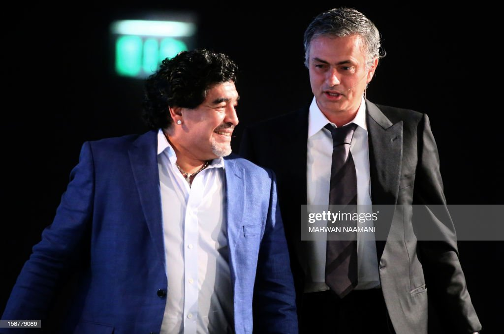 Argentinian football icon and former player Diego Maradona (L) and Real Madrid's Portuguese coach Jose Mourinho walk before attending a panel discussion during the first session of the International Sports Conference in Dubai on December 28, 2012.