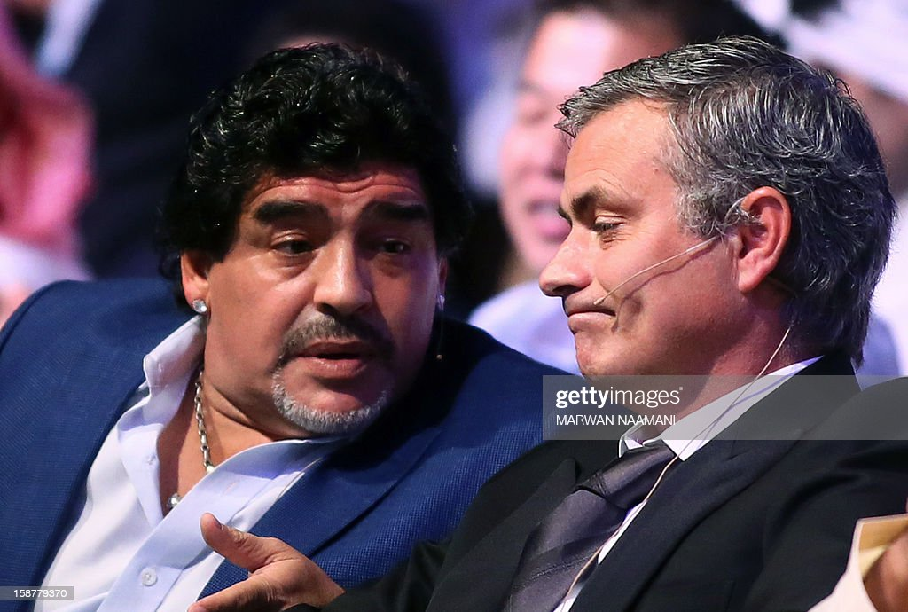 Argentinian football icon and former player Diego Maradona (L) and Real Madrid's Portuguese coach Jose Mourinho chat before attending a panel discussion during the first session of the International Sports Conference in Dubai on December 28, 2012. AFP PHOTO/MARWAN NAAMANI