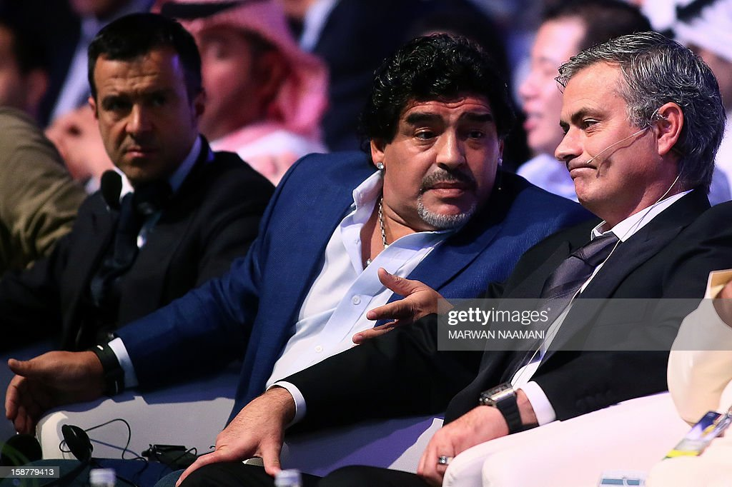 Argentinian football icon and former player Diego Maradona (C) and Real Madrid's Portuguese coach Jose Mourinho (R) chat before attending a panel discussion during the first session of the International Sports Conference in Dubai on December 28, 2012.
