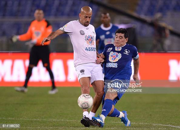 TOPSHOT Argentinian football legend Diego Armando Maradona vies with Argentina's Juan Sebastian Veron during the 'Match of Peace United for Peace'...