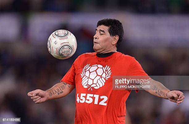 Argentinian football legend Diego Armando Maradona warms up during the 'Match of Peace United for Peace' charity football match promoted by the...