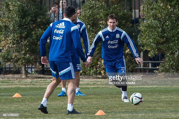Argentinian football player Lionel Messi chases the ball during a training session of the Argentinian national team at Georgetown University in...