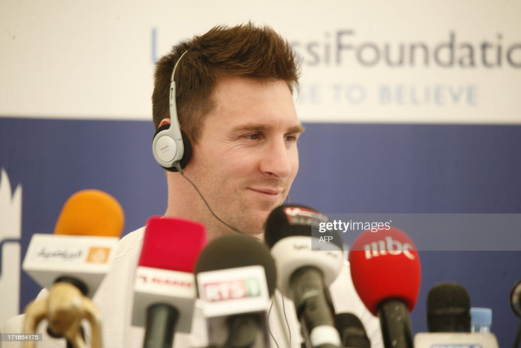 Argentinian football star Lionel Messi gives a press conference on June 27, 2013 in Mbour, as part of a humanitarian visit to Senegal. Barcelona star Lionel Messi flew into in Senegal on June 27 to distribute mosquito nets in a bid to reduce outbreaks of deadly malaria.