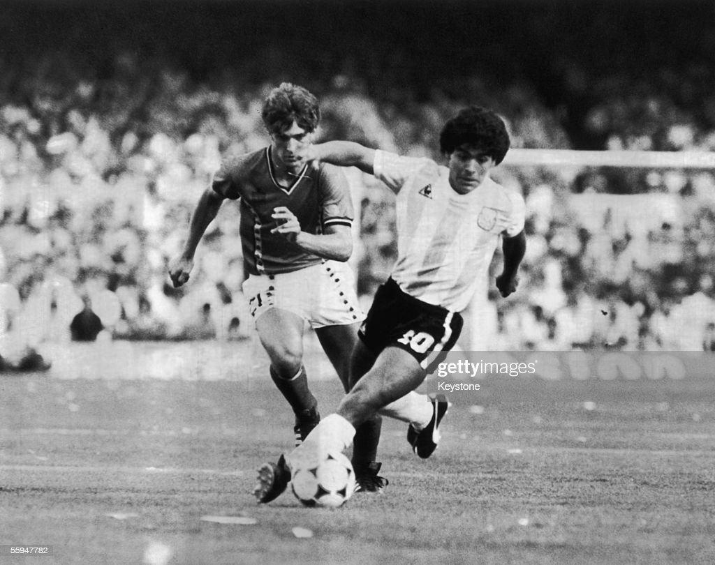 Argentinian footballer Diego Maradona (right) and Belgium's Alexander Czerniatynski in action during the opening match of the World Cup at the 'Camp Nou' stadium in Barcelona, 13th June 1982.