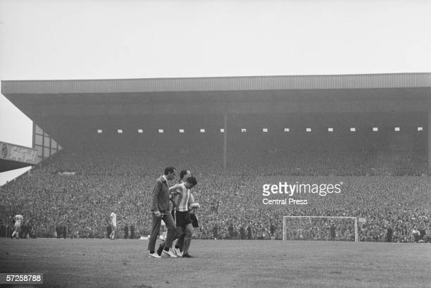 Argentinian footballer Jorge Albrecht is lead from the pitch at Villa Park after being sent off in the Group B match against West Germany during the...