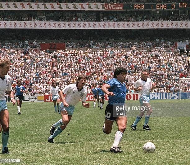 Argentinian forward Diego Armando Maradona runs past English defenders Terry Butcher and Terry Fenwick on his way to scoring his second goal during...