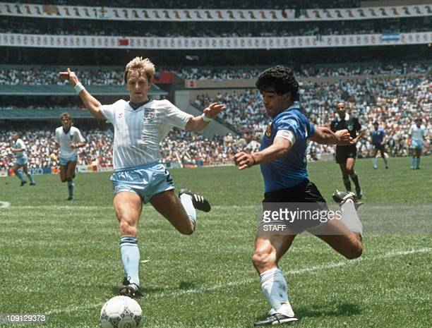 Argentinian forward Diego Maradona gets ready to cross the ball under pressure from English defender Gary Stevens during the World Cup quarterfinal...
