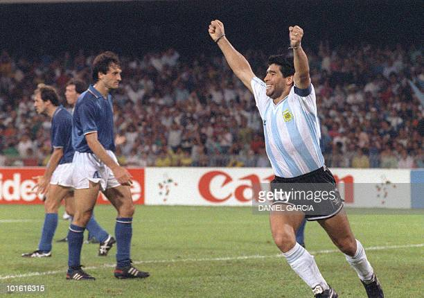 Argentinian forward Diego Maradona R celebrates after teammate Claudio Caniggia tied the score at 1 during the World Cup semifinal soccer match...