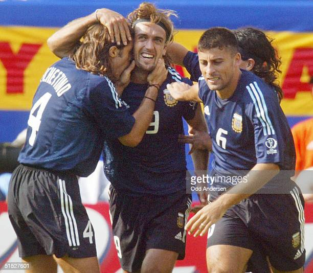 Argentinian forward Gabriel Batistuta is congratulated by his teammates after he scored a goal during the Argentina/Nigeria Group F match of the...