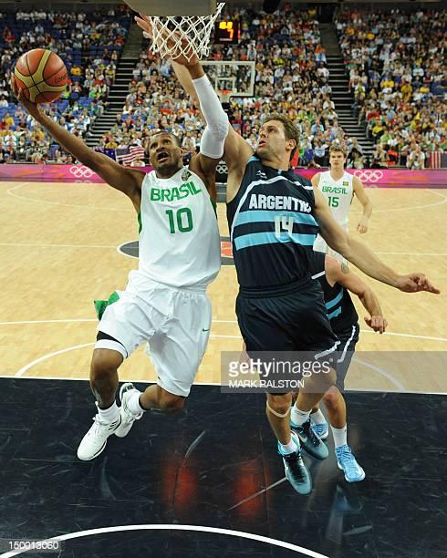 Argentinian forward Hernan Jasen challenges Brazilian guard Leandrinho Barbosa during their London 2012 Olympic Games men's quarterfinal basketball...