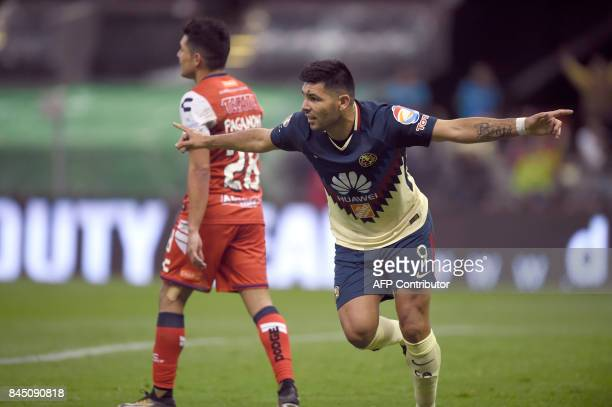 Argentinian forward of America Silvio Romero celebrates his second goal against Veracruz during their Mexican Apertura tournament football match at...