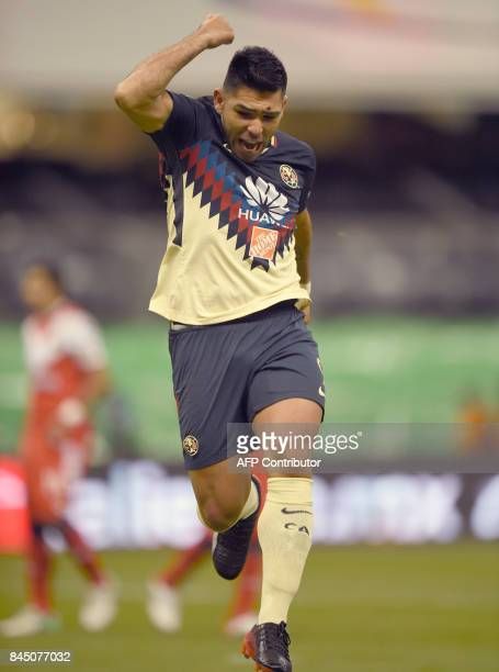 Argentinian forward Silvio Romero of America celebrates his goal against Veracruz during their Mexican Apertura tournament football match at the...