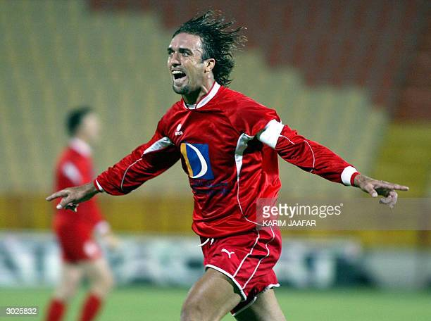 Argentinian Gabriel Batistuta of alArabi celebrates after scoring a goal against alSadd during their Qatari league match at alRayan stadium in Doha...