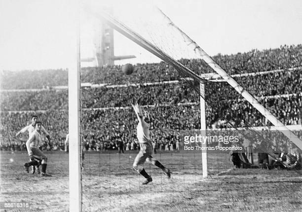 Argentinian goalkeeper Juan Botasso is beaten by Hector Castro for Uruguay's 4th goal during the FIFA World Cup Final at the Estadio Centenario in...
