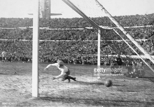 Argentinian goalkeeper Juan Botasso is beaten by Pedro Cea's shot for Uruguay's 2nd goal during the FIFA World Cup Final between Uruguay and...